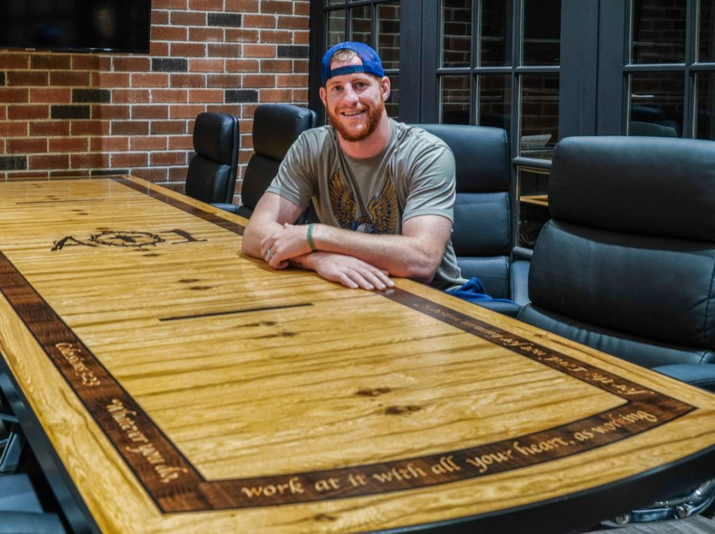 Carson Wentz AO1 Foundation logo table