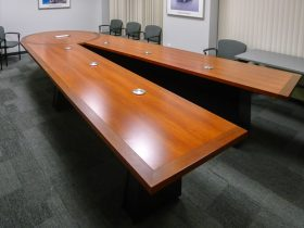 scissoring conference table