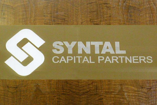 Syntal Glass Conference Table Logo